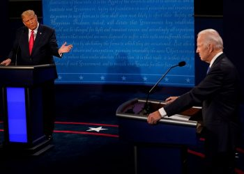 U.S. President Donald Trump gestures toward Democratic presidential candidate former Vice President Joe Biden during the second and final presidential debate at the Curb Event Center at Belmont University in Nashville, Tennessee, U.S., October 22, 2020. Morry Gash/Pool via REUTERS